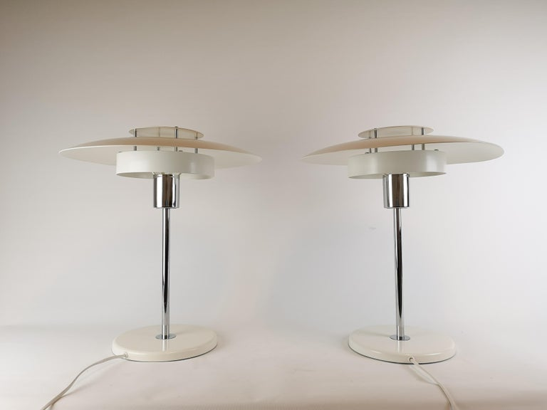 These two table lamps were designed by Ole Andersson and manufactured at Borens Sweden in the 1970s.   Good working condition, some scratches and marks.   Measures: H 47 cm, D 40 cm.