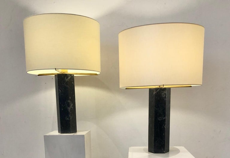Pair of table lamps in black marble by Jules Wabbes, new shade. Measures: 44.5 cm x 66 cm with shade, 40 cm x 43.5 cm without shade.