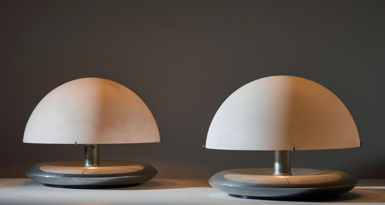 Pair of table lamps. Manufactured in Italy for Venini, circa 1970s. Opaline glass diffusers, with nickel plated brass base. Original cord with on/off hand switch. Takes one E26 75w maximum bulb.