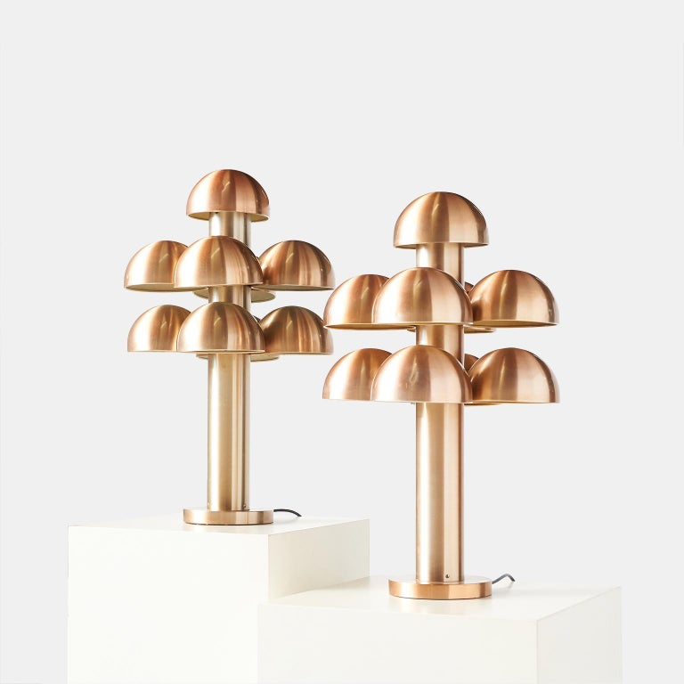 """Pair of table lamps """"Cantharelle"""" by Maija Liisa Komulainen for RAAK An extremely rare and collectible pair of mushroom shaped lamps in anodized aluminum. Each lamp has 9 working sockets with shades. Made for RAAK in 1972."""