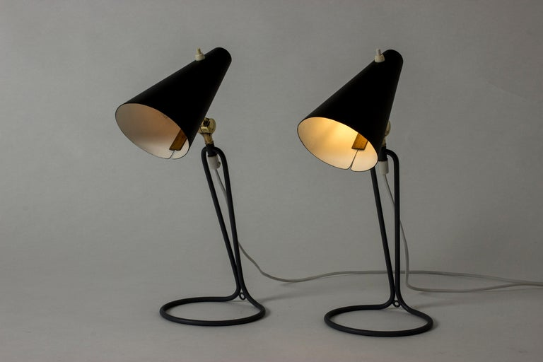 Pair of amazing table lamps by Bertil Brisborg, with black lacquered shades. Cool grey base in a slender graphic design. Contrasting brass joints.