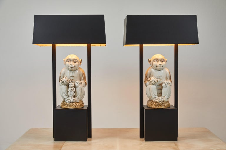 A unique and rare pair of painted metal lamps, both base and shades. These lamps are from the estate of Tony Duquette and still retain their Christies lot stickers. As seen in image #5. They have been repainted and rewired. The same model of lamp