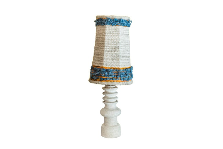 Pair of table lamps, Stone decorated with rings,  Woolen lampshades,  circa 1950, France.   Measures: Diameter 39 cm, height 95 cm.