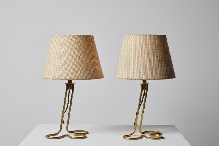 Pair of Table/Wall Lights by Mauri Almari for Idman Oy. Designed and manufactured in Finland, circa 1950s. Brass base, textured linen shades. Can be mounted on wall or used as table lamps. Each light takes one E27 75w maximum bulb. Bulbs provided as