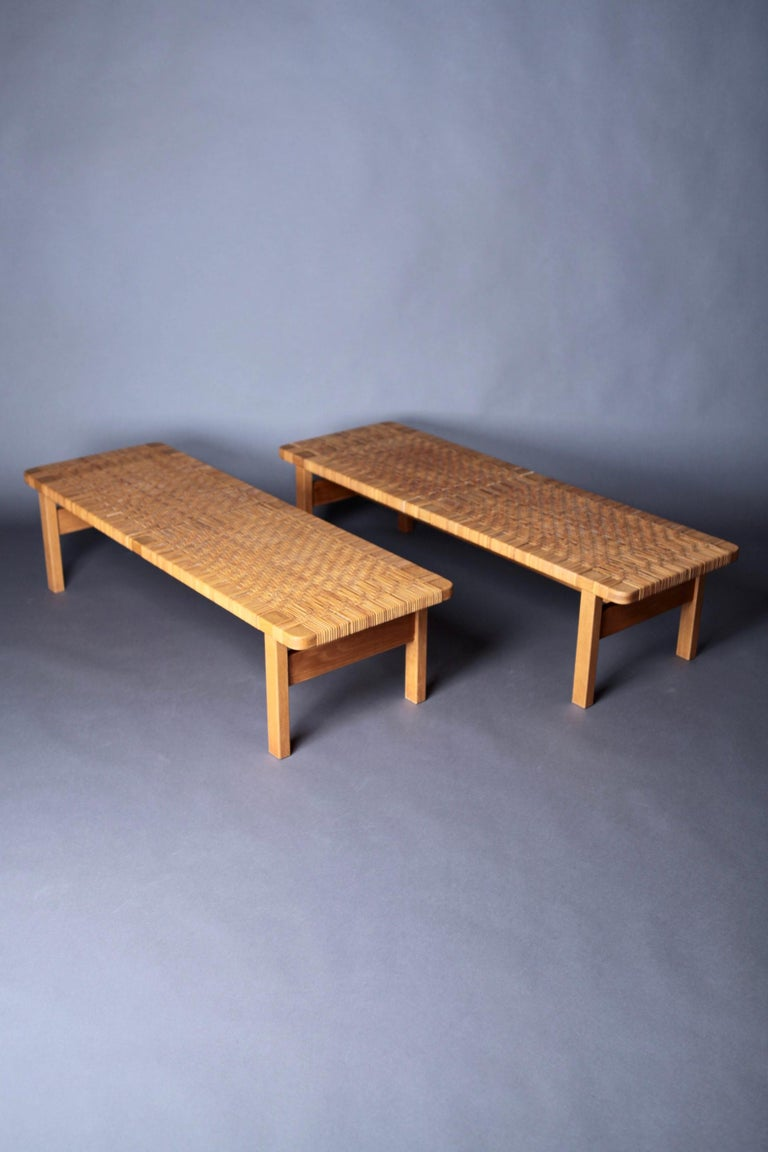A pair of large occasional tables or benches, model 5272, designed by Børge Mogensen for Frederica Stolefabrik, Denmark 1950s. Oak and cane.