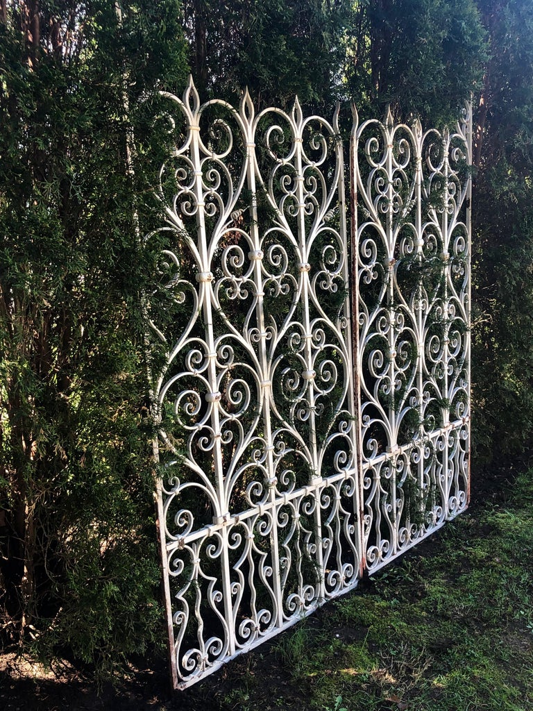 Yes, we do have a thing for gates, particularly early and high- quality ones like this tall pair of hand-wrought iron gates that date to around 1830. Their size, intricate detailing, and romantic feel make them the perfect sentinels for your