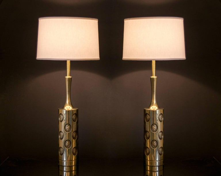 An elegant pair of vintage Rembrandt brass lamps with coin inlays detailed with black lacquer. Excellent condition, recently re-wired.