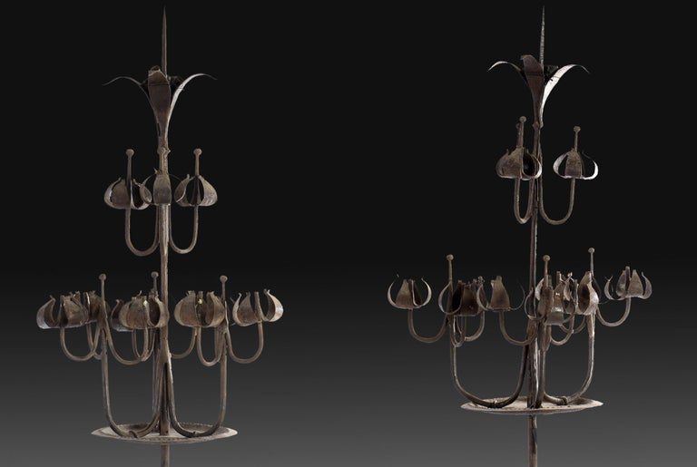 Pair of standing Gothic Revival candlesticks. Wrought iron Spain, 20th century. Pair of wrought iron standing candelabra with a tripod as a base, an axis decorated with small discs and ending in a circular plate, and an upper part made up of three