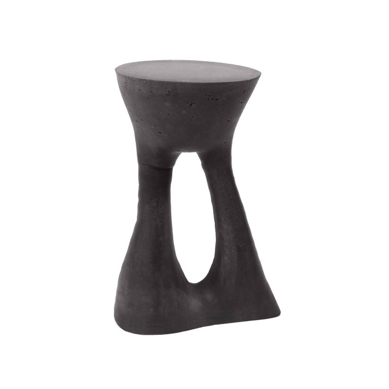 This listing is for two tall charcoal tables.   Industrial, organic and sculptural, the Kreten side tables are concrete furniture like you haven't seen before. Original pieces are created in Souda's Brooklyn studio by casting concrete into a spandex
