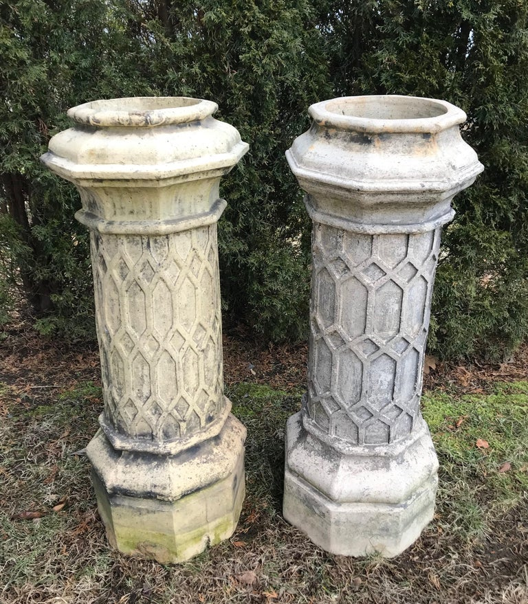 This stunning pair of tall chimney pots with outstanding hexagonal decoration was sourced from a fine Norfolk country manor and are the perfect receptacles for large, effusive flowering pots. Although unsigned, they are reliably attributed to