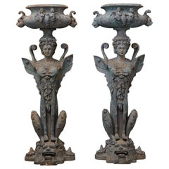 Pair of Tall Patinated Cast Iron Planters Showing Mythical Creatures / Chimeres