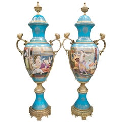 Pair of Tall Porcelain Urns Hand Painted with Orientalist Harem Scenes