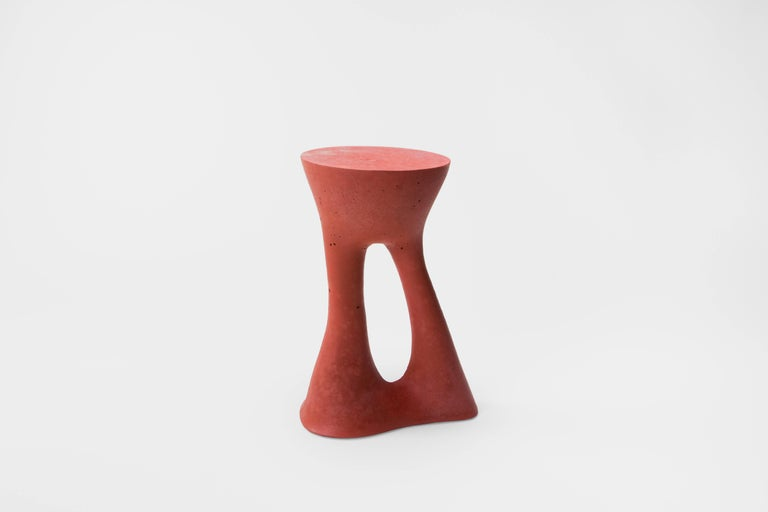This listing is for two tall red tables.   Industrial, organic and sculptural, the Kreten side tables are concrete furniture like you haven't seen before. Original pieces are created in Souda's Brooklyn studio by casting concrete into a spandex
