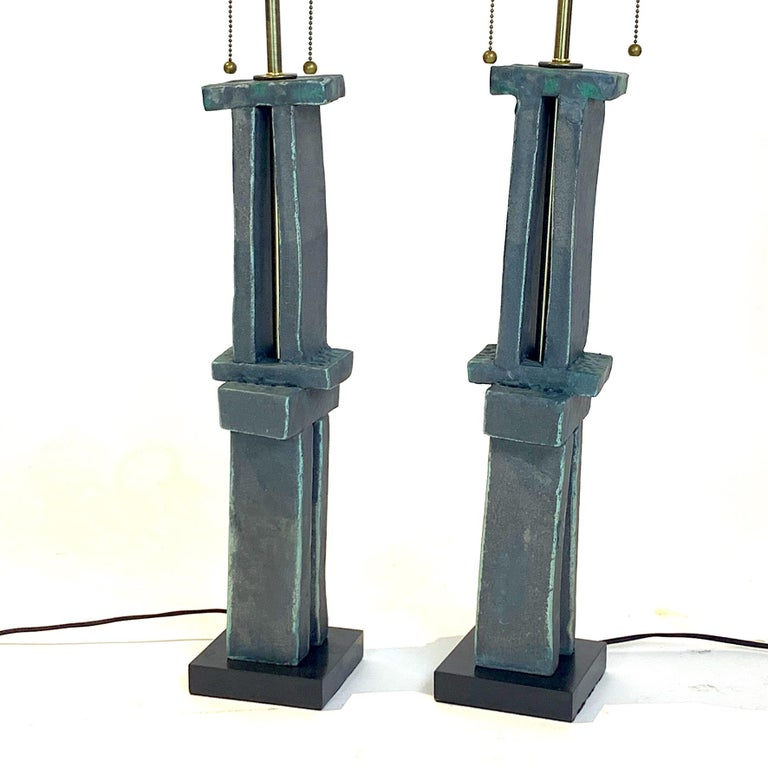Amazing hand-built sculpture lamps created by Hudson, NY based artist Judy Engel. These stunning weathered bronze glazed totems have been finished with the best lighting hardware in brass with solid wood bases and cloth covered wiring. Absolutely