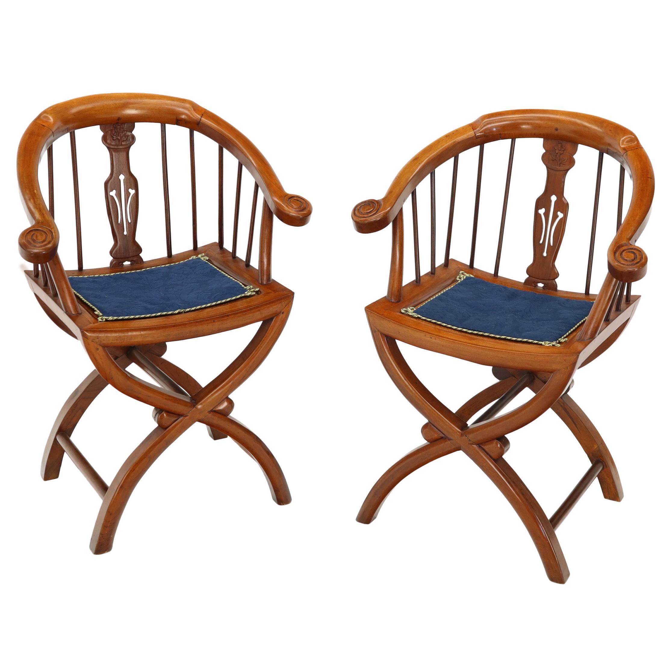 Pair of Teak Horseshoe Back Lounge Chairs