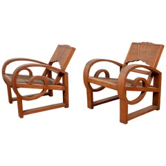 Pair of Teak Wood Country Chairs from Madura with Rattan Seats and Looping Arms