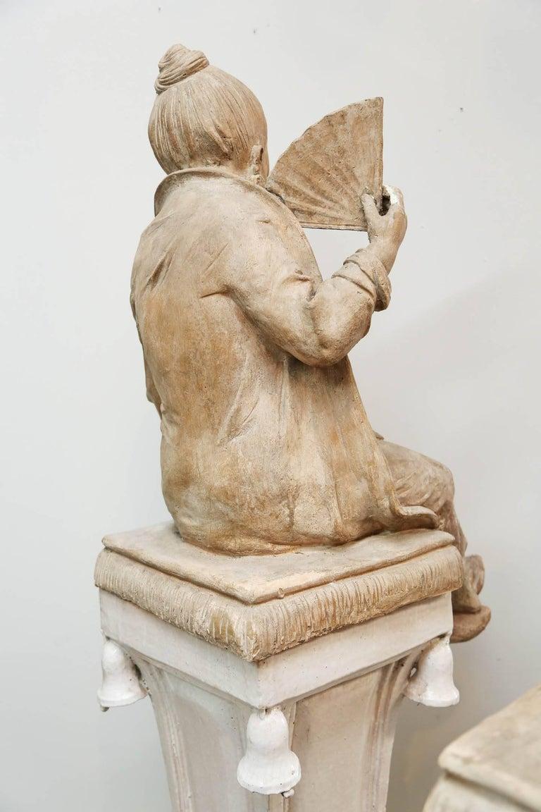 Italian Pair of Terracotta Chinoiserie Figures on Ceramic Columns
