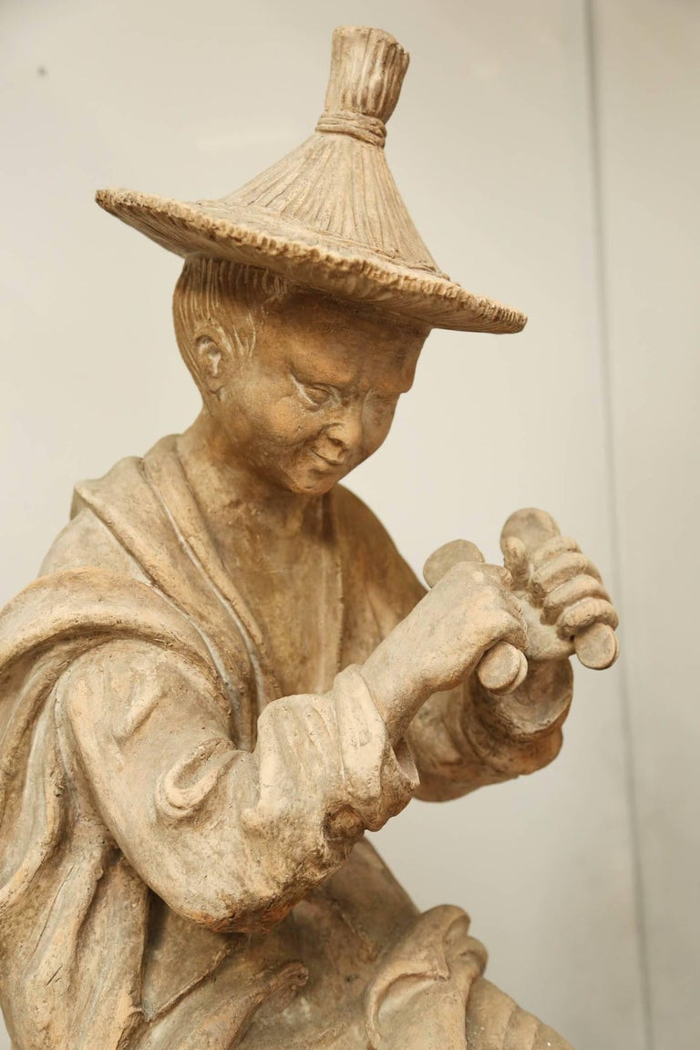 Pair of Terracotta Chinoiserie Figures on Ceramic Columns 1