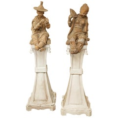 Pair of Terracotta Chinoiserie Figures on Ceramic Columns