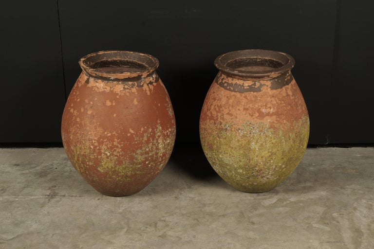 Pair of terracotta urns from France, circa 1970. Nice original color and patina.