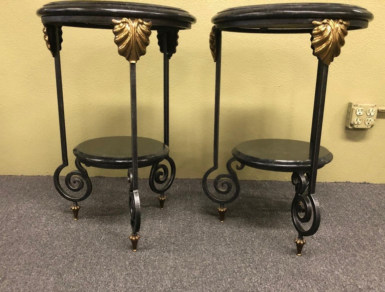 Gorgeous pair of tessellated black marble, brass and wrought iron two-tier side tables by Maitland Smith, circa 1990s.
