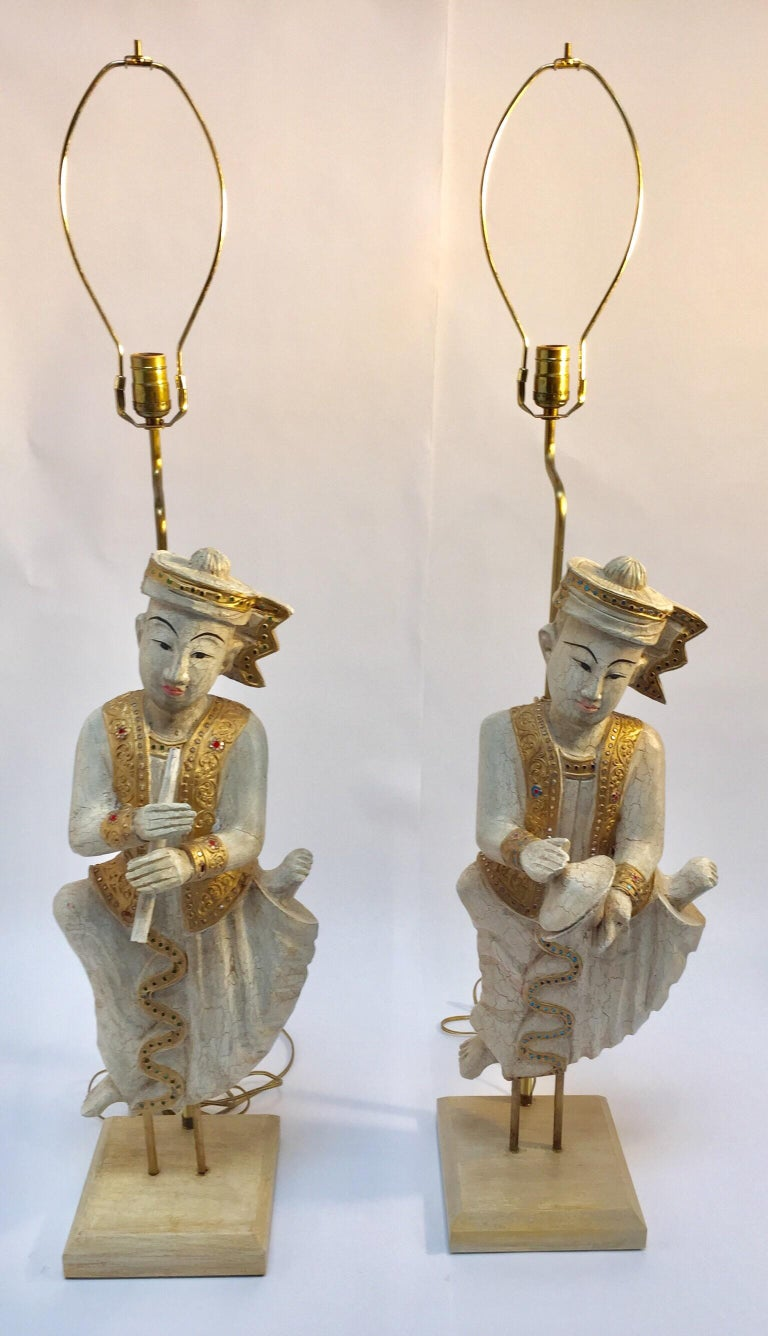 Large pair of Thai figures of Siamese musicians, nicely carved turned into table lamps.
