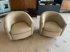 Pair of Thayer Coggin SWIVEL BARREL BACK ARMCHAIRS