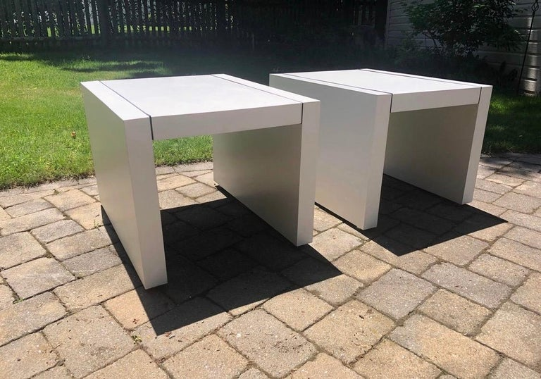 Parsons table that match from Thayer Coggin, circa 1970s. Features clean, white Formica with black trim design. Underneath, there is a heavy wooden frame. The tables are supported by four chrome feet at the base. Iconic, Minimalist design, clean