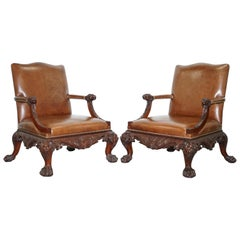 Pair of Thomas Chippendale Brown Leather Library Armchairs Hand-Carved Lions