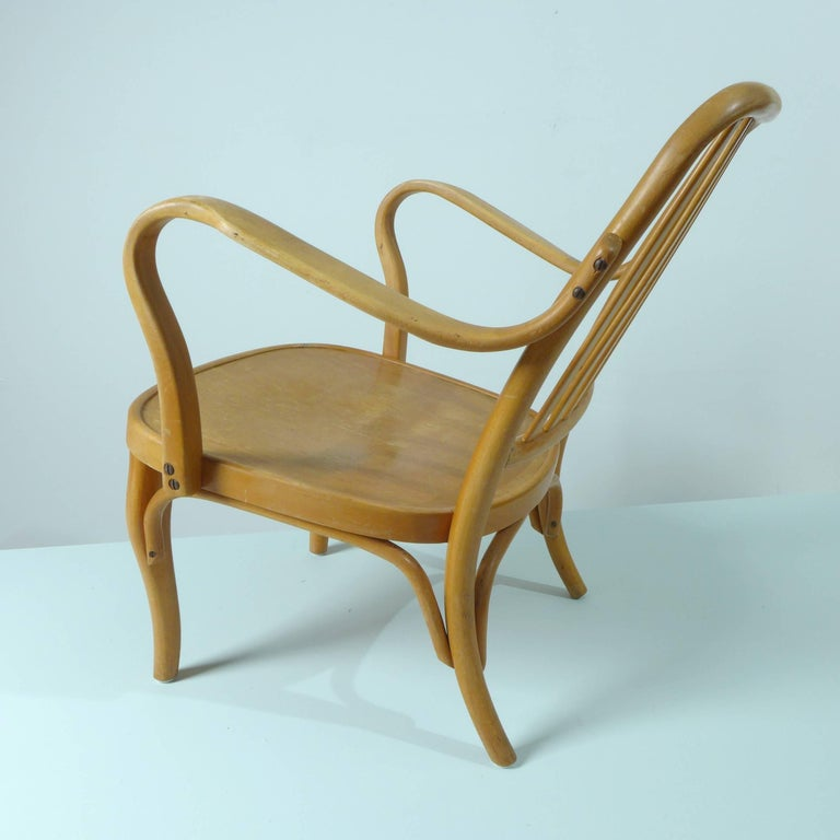 A pair of bent beechwood armchairs