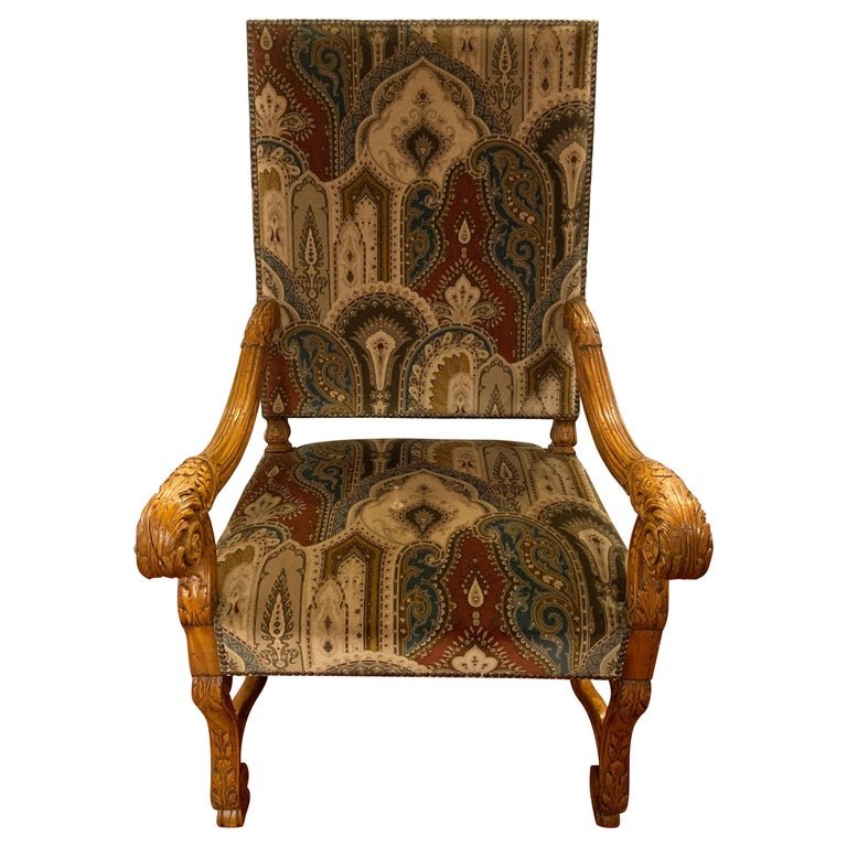 Pair of Throne armchairs with a Versace style cut and printed velvet fabric. These stunning King and Queen Throne chairs are certainly fit for a King and Queen. The turn of the century pair having fully carved arms and sides with a robust carved