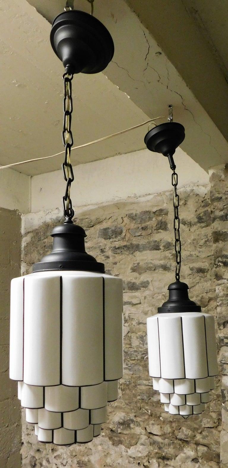 Pair of tiered milk glass art deco skyscraper pendant lights circa 1930 in good condition