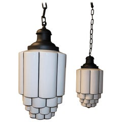 Pair of Tiered Milk Glass Art Deco Skyscraper Pendant Lights, circa 1930