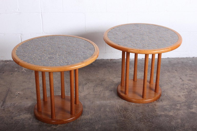 A pair of teak tables with ceramic tiles by Gordon Martz for Marshall Studios.