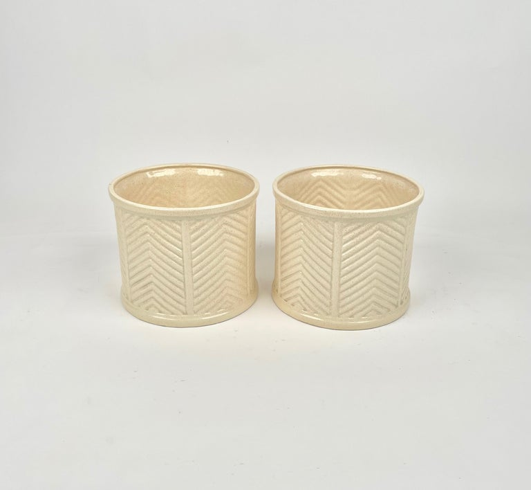 Pair of beige ceramic vases by B Ceramiche for Tommaso Barbi. Made in Italy in the 1970s.   They both have the original stamp