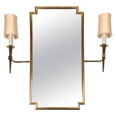 Pair of Tommi Parzinger Brass Sconces Together with Giltwood Mirror