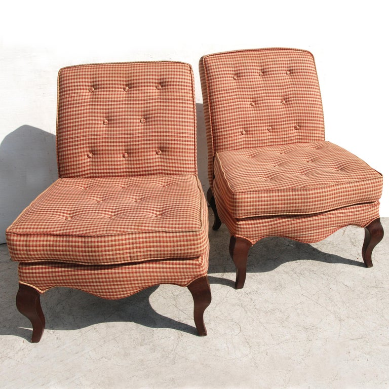 Two Queen Anne slipper chairs, wood legs and upholstery. Would recommend that they be reupholstered, some wear on fabric.