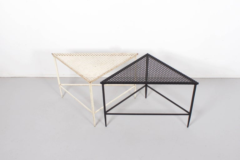 Beautiful pair of Mathieu Matégot tables in good condition.  Manufactured by Artimeta in the 1950s  Perforated metal top and frame lacquered in black and white.   Because of the triangular shape of the tables they can be combined in many ways.  A