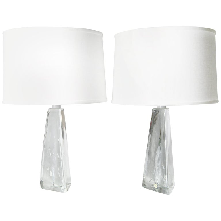 Pair of triangular solid clear crystal lamps with bubbles in the glass by the glassmaker Aneta which was located in the town of Vaxjo Sweden, 1980 Sweden signed in great condition clear crystal with air bubbles organically shaped in the inside of
