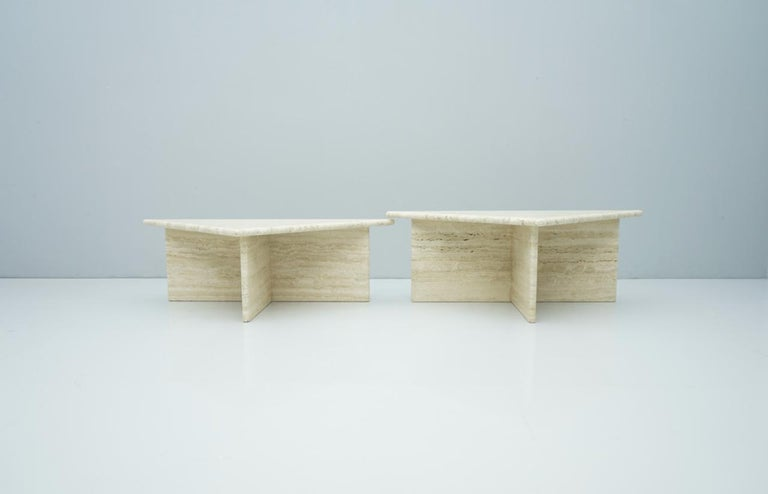 Pair of triangular travertine side or coffee table Italy 1970s in different height.