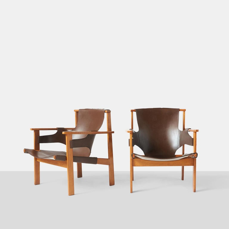 """Pair of """"Trienna"""" armchairs by Carl-Axel Acking A pair of armchairs in leather with oak frames for Nordiska Kompanient designed in 1957 and model #563-059. Sweden, circa 1950s."""