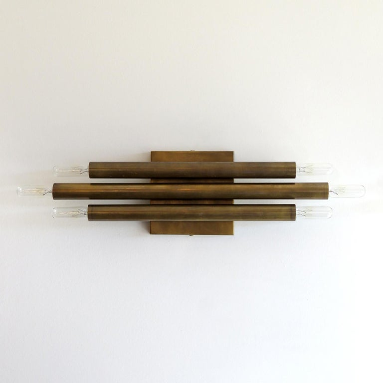 Great pair of geometric wall lights by Gallery L7 with three brass double candles. Six E12 sockets per fixture, max. wattage 40w each, UL listing available upon request for an additional charge. Multiples available.