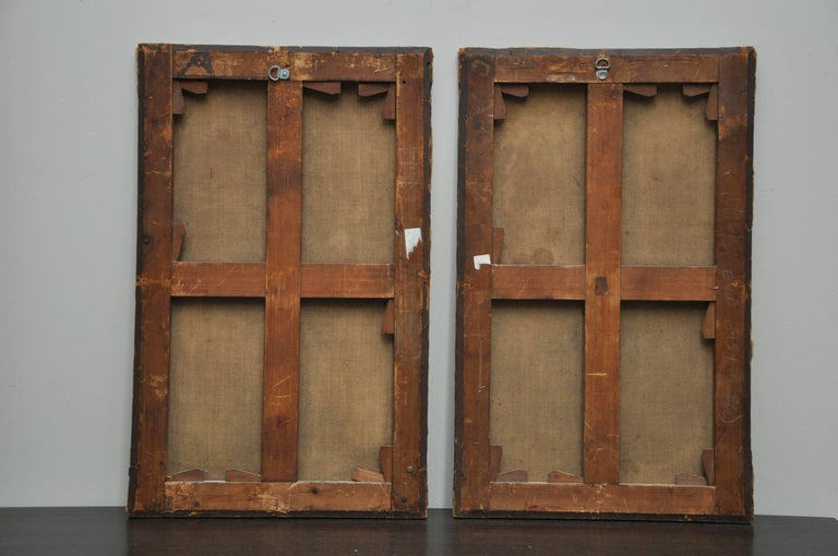 This pair of 19th century oil on canvas paintings are trompe l'oeil in style in tones of warm cream and brown.