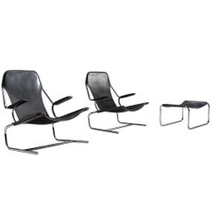 Pair of Tubular Lounge Chairs and Ottoman in Black Leather Upholstery