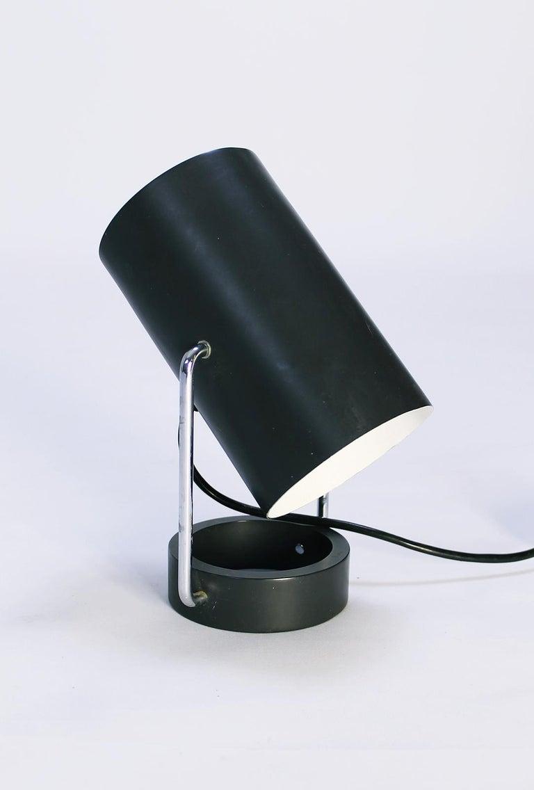 Stunning vintage 1960s table lamp from Tulux, Switzerland. Adjustable tube shade. Chrome and dark grey enameled metal. One E27 socket, max 75 watt.