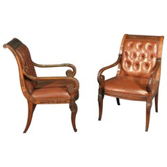 Pair of Tufted Carved Mahogany French Regency Style Leather Armchairs