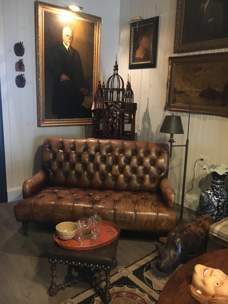 Handsome tufted English library settee in antiqued leather. I have a pair of lounge chairs from same suite. One settee has sold.  Great scale, color and patina.