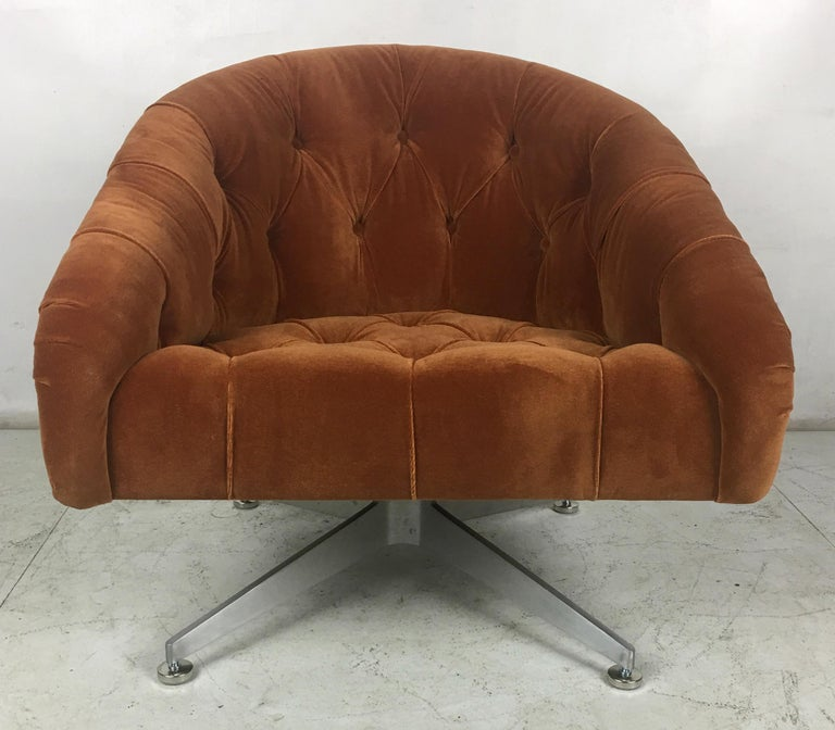 Pair of modern swivel chairs by Ward Bennett for Lehigh Leopold. The chairs have been painstakingly restored from the ground up. The bases have been professionally refinished in their original lightly brushed finish and the chairs have been