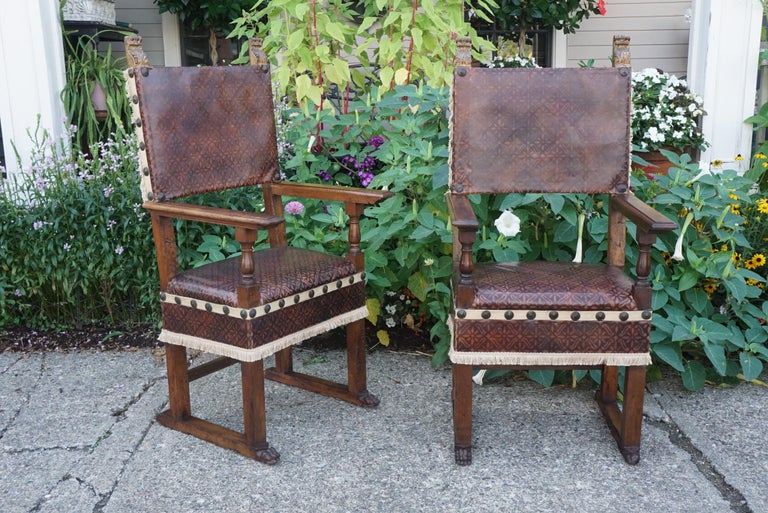This pair of carved Italian walnut chairs where made in the 18th century copying a 16th century form. All the members are cut from large heavy walnut timber with a nice rich warm mellow color and patina. The construction method is with mortise and