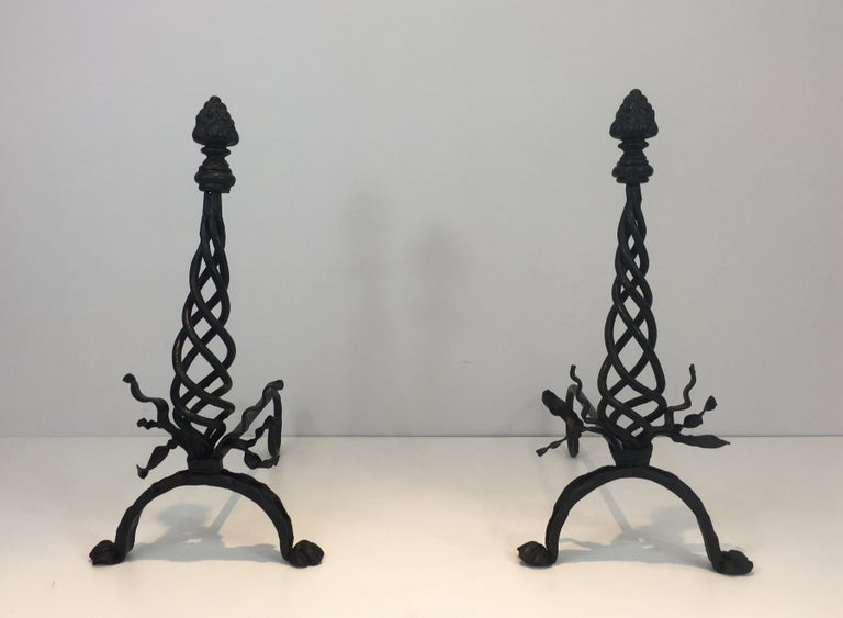 This pair of wrought iron is made of a twisted central part with rubans on the base and a large finial on top. They are French, circa 1920